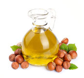 Filbert oil with nuts. Filbert oil with hazelnuts nuts  close up on white Royalty Free Stock Photo