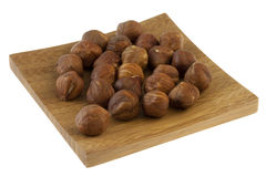 Filberts (hazelnuts) on a small wooden tray Royalty Free Stock Photo