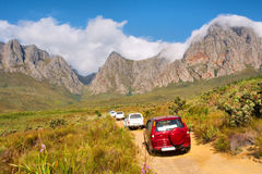 File of 4x4 cars driving up mountains stock photos