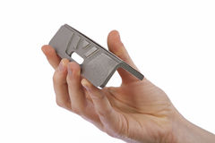 File bevel guide for skis. Hand holding a bevel guide for ski tuning royalty free stock photos