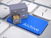 File cabinet on computer keyboard Royalty Free Stock Images