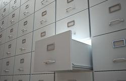 File cabinets. File cabinet with an open drawer and light Royalty Free Stock Image