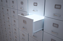 File cabinets. File cabinet with an open drawer and light Royalty Free Stock Images