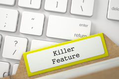 File Card with Inscription Killer Feature. 3D. Killer Feature written on Yellow Folder Index Concept on Background of White Modern Computer Keypad. Closeup View Stock Photo