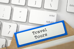 File Card with Inscription Travel Tours. 3D. Travel Tours. Orange Folder Index Concept on Background of White Modern Computer Keyboard. Business Concept Stock Photo