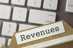 File Card Revenues. 3D. Revenues. Folder Index on Background of Modern Laptop Keyboard. Business Concept. Closeup View. Selective Focus. Toned Image. 3D Royalty Free Stock Images