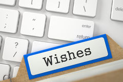 File Card with Wishes. 3d. Wishes Concept. Word on Orange Folder Register of Card Index. Closeup View. Selective Focus. 3D Rendering Royalty Free Stock Image