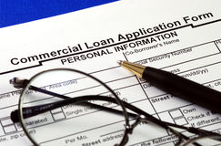 File the commercial loan application. Isolated on blue Stock Photos