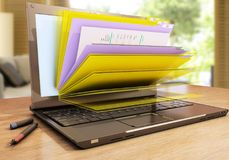 File in database - laptop with folders Royalty Free Stock Photography