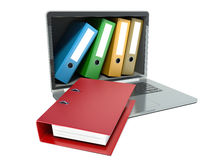 File in database - laptop with ring binders Royalty Free Stock Image