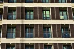 File dei balconi con i ciechi fotografia stock