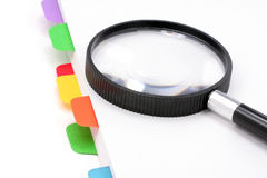 File divider and magnifier stock photo