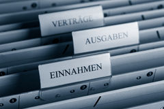 File Folder. Close up view of a file folder in german language: contract, income and expenditure Stock Photography