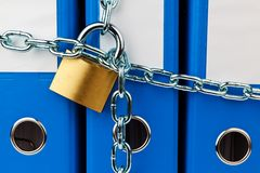 File folder closed with chain. A file folder with chain and padlock closed. privacy and data security Stock Image