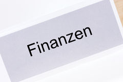 File folder Finances Finanzen in German language. On white background Royalty Free Stock Image