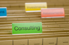 File folder labeled with Consulting Stock Photo