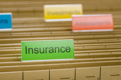 File folder labeled with Insurance Stock Photos