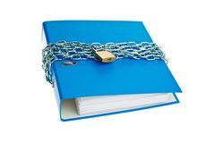 File folder locked with chain. A file folder with chain and padlock closed. Privacy and data security Stock Photos