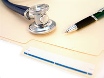 File folder, pills and pen Royalty Free Stock Images