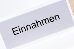 File folder revenue Einnahmen in German language. On white background Stock Photography