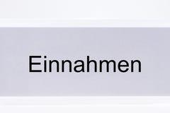 File folder revenue Einnahmen in German language. On white background Royalty Free Stock Photos