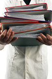 File folders. Man holding a pile of file folders Royalty Free Stock Photos