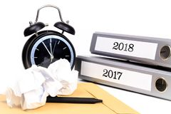 File folders and alarm clock symbolize time pressure while worki. Ng on the plans for 2018 Royalty Free Stock Image