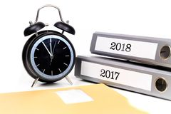 File folders and alarm clock symbolize time pressure while worki. Ng on the plans for 2018 Royalty Free Stock Photos