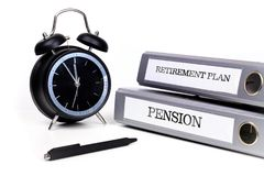 File folders and alarm clock symbolize time pressure while worki. Ng on retirement plan and pension Stock Photo