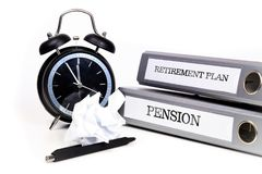 File folders and alarm clock symbolize time pressure while worki. Ng on retirement plan and pension Royalty Free Stock Images