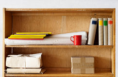 File folders and books standing on the shelve Stock Images
