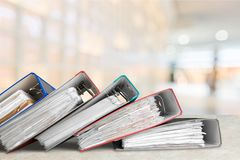 File folders with documents. Documents folders white background paper business store stock image
