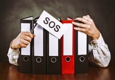 File folders with hands and SOS sign Royalty Free Stock Photos