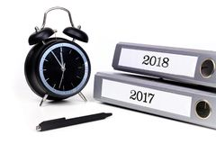 File folders, pen and alarm clock symbolize time pressure while. Working Stock Image