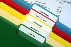 File Folders of Personal Bills. This is an image of the tabs on various file folders of bills stock photo