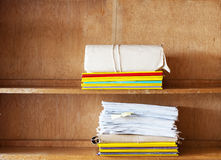 File folders, sheets of paper on the shelve Royalty Free Stock Photography