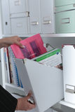 File folders, standing on shelves in the background Royalty Free Stock Photos