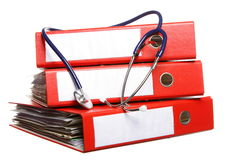 File folders with stethoscope isolated on white Stock Images