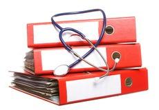 File folders with stethoscope isolated on white Stock Photo