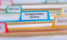 File folders with a tab labeled Occupational Safety stock image