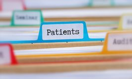 File folders with a tab labeled Patients stock photos