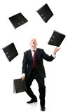 File juggling. Concept of multi tasking in business, man juggling files isolated on white background stock image
