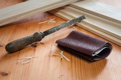 File and sandpaper. File and sanpaper on a wooden table Royalty Free Stock Photos