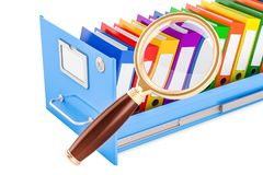 File search concept. Folders inside filing cabinet with magnifyi. Ng glass Royalty Free Stock Photo