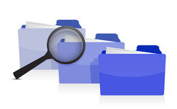 File search concept: folders and magnifying glass Royalty Free Stock Photo