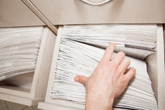 File searching. Person is searching through some files in the drawer royalty free stock photos