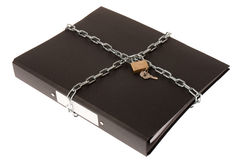 File Security. A ring binder wrapped up in a chain and padlock Royalty Free Stock Images