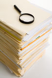 File Stack and Magnifying Glass Royalty Free Stock Images