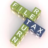 File tax return 2. Words file tax return in a crossword, tax in blue and other words in army green color on white reflective surface stock illustration