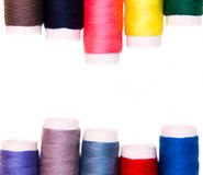 File in the top and bottom of sewing thread in different colors Stock Photography
